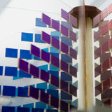 Abstract image with several small square pieces in blue, aubergine and red. Photo by Aalto University / Mikko Raskinen