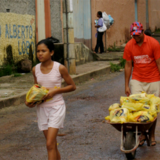 Two people hauling bags in Brazil