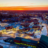 An aerial view of the Aalto University campus at sunset/ Photo by Mika Huisman