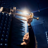 Woman adjusting the equipment in ELEC radio room / photo by Aalto University, Unto Rautio