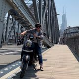 School of Business alumni Li Xu on her motorbike in China.