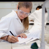 An image of a student making calculations on paper