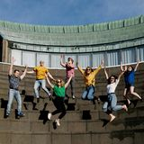 Students jumping for joy at the Amphitheater stairs.
