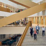 Four students descending stairs in the School of Economics building. Photo taken by Unto Rautio.