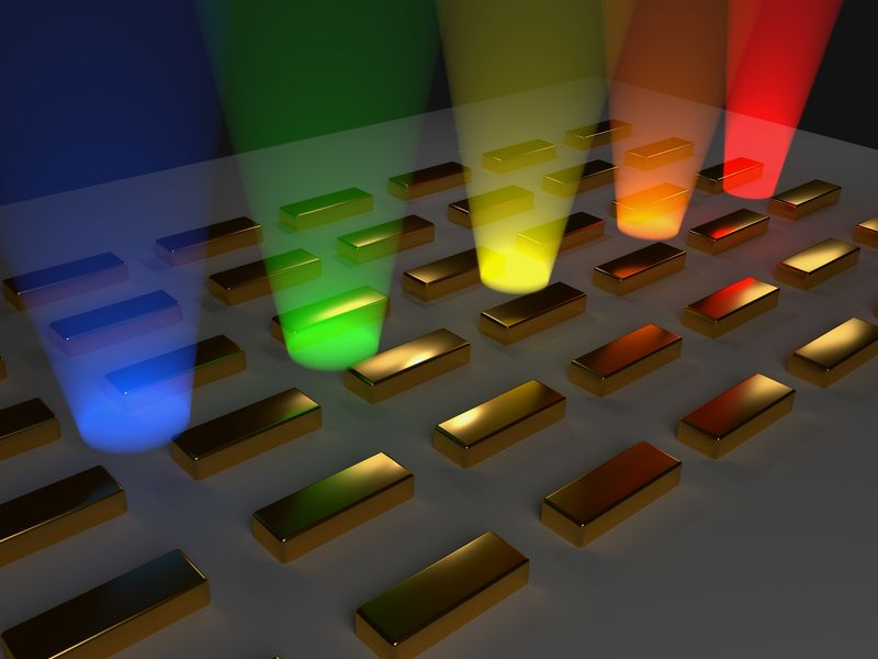 Bosen–Einstein condensate of light and gold particles