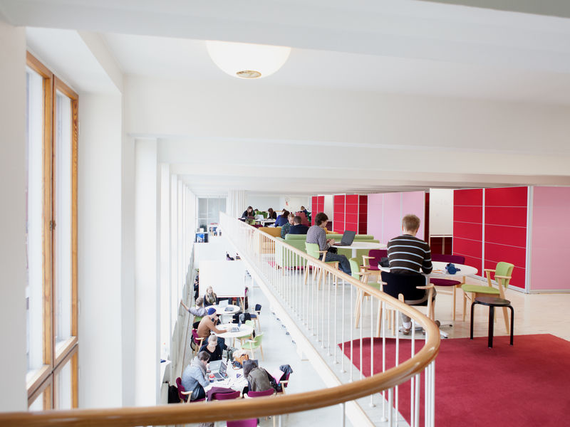 A study space with students working inside Herald Herlin Learning hub