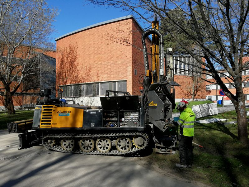 A construction worker reparing a drilling rig on the Otaniemi campus.