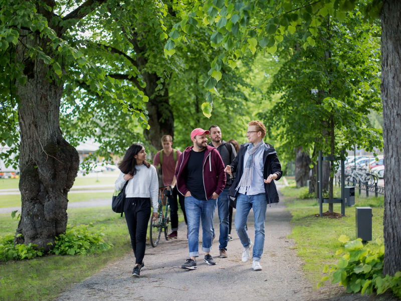 Students walking on the Aalto campus in the spring. Photo by Aalto University