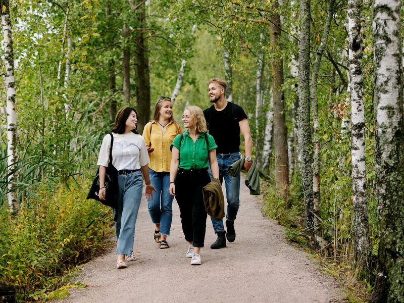 Students walking down a nature path.