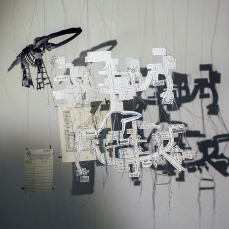 The art piece Railtrack Songmaps by Lucy Davis, a hanging mobile, is exhibited
