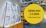 Aalto University logo as light sign next to a circle with the text Demo Day 5.3.2020 @Aalto Startup Center in it
