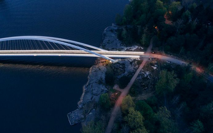 A bridge by the sea, image shot from the air in the evening