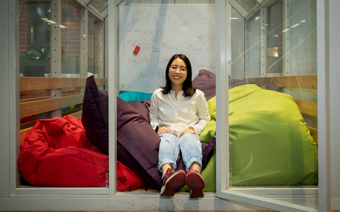 Linh Nguyen sitting in a room full of Fatboy beanbags