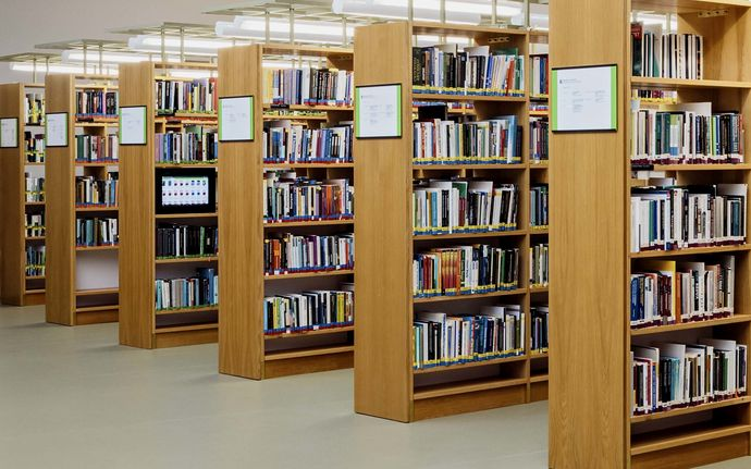Bookshelves full of books at Aalto University Learning Centre