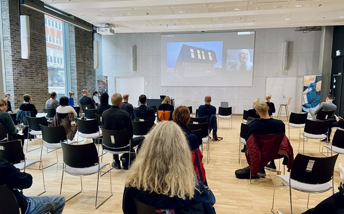 People listening to a remote talk by Jenny Osuldsen (from Norway) streamed at KYMP House as part of the Nordic CityMaking Week.