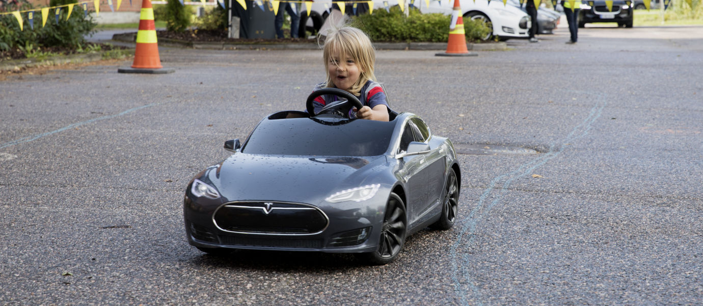 Aalto University / a kid driving a mini Tesla / photo: Annamari Tolonen