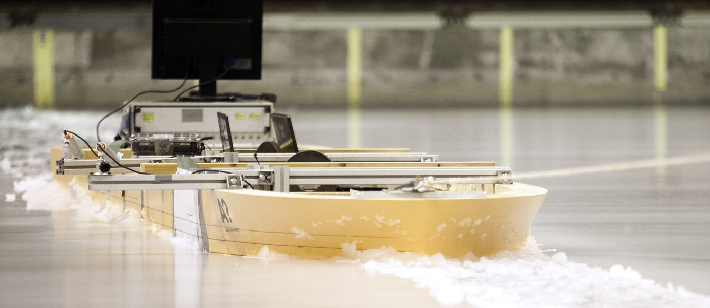 Model ship through ice in Aalto Ice Tank basin
