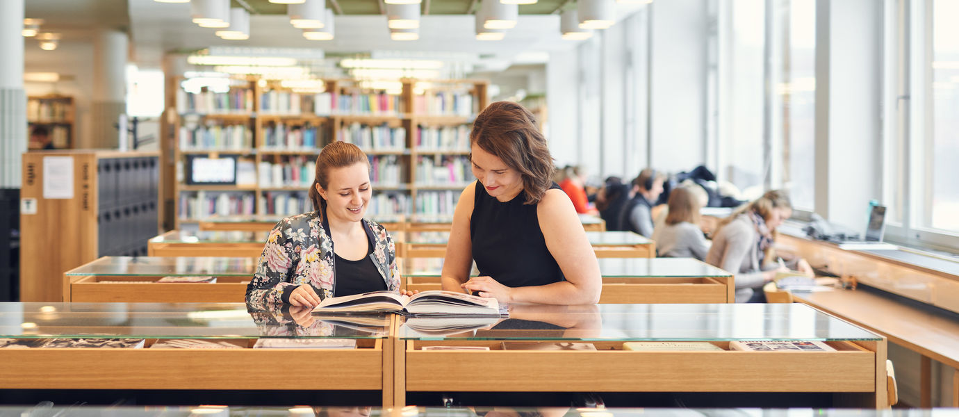 Two students at the Aalto University Learning Centre