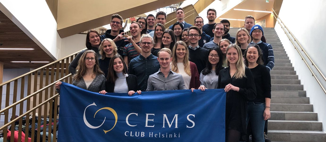 CEMS students standing on the main stairs of the School of Business