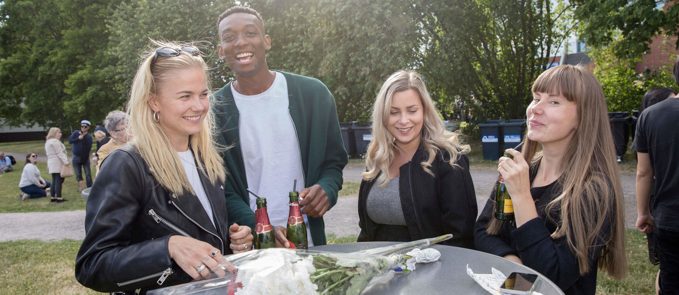 Young alumni celebrating their graduation at Aalto Graduation Party 2018.