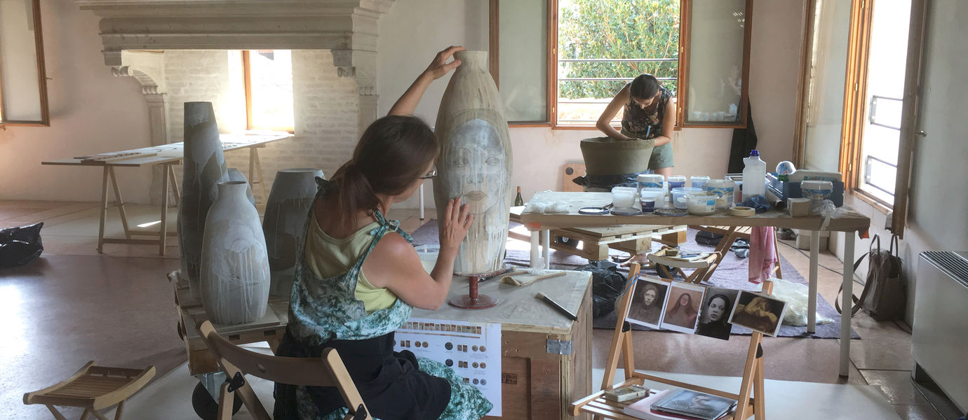 Coiling vases from the local earthenware and painting the vases with the local earth in Earth Laboratory, Venice, August 2019. Photo: Catharina Kajander