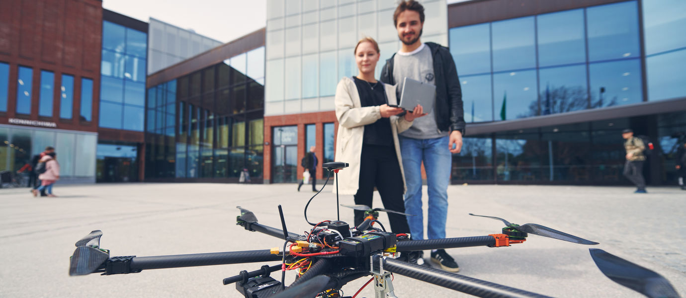Geoinformatics students operate a drone at Aalto University.