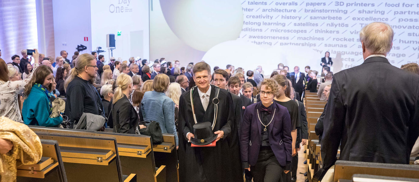 President Ilkka Niemelä and AYY Chair Noora Jaakkola in the middle, leaving the auditorium in Aalto Day One 2018 ceremony.
