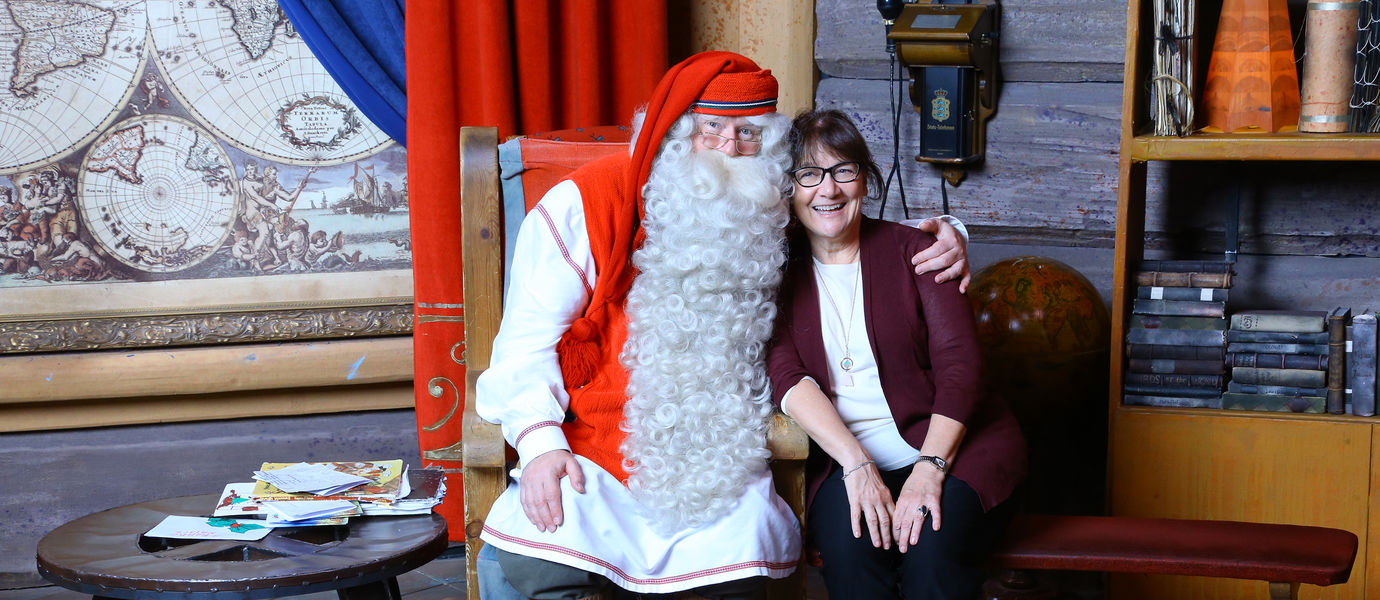 Visiting professor Beryl Pittman visiting Santa Claus in Finland.