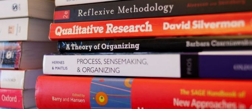 Stack of management books.