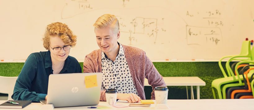 Two Aalto University students working on a laptop together / photo by Unto Rautio