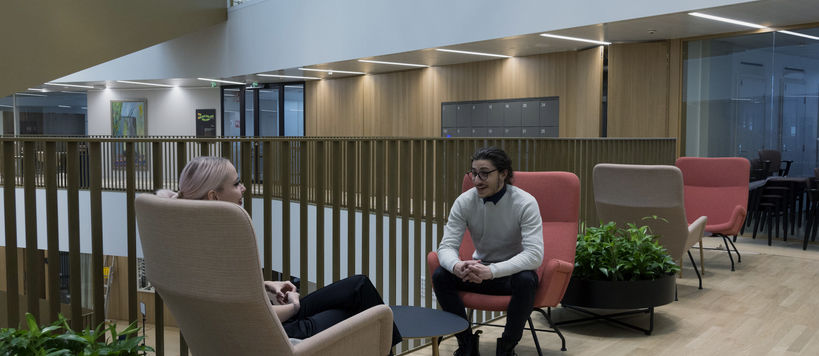 The photo shows students at the new School of Business / Photo: Roope Kiviranta