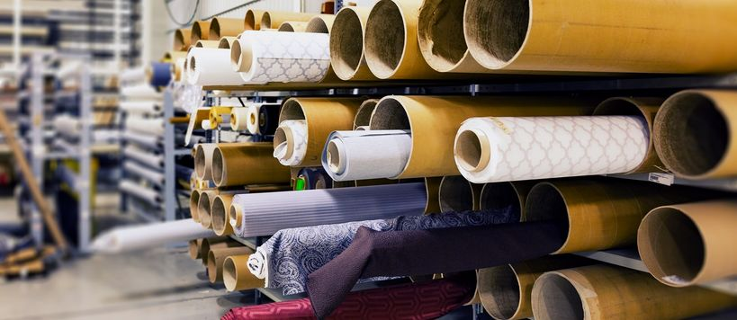 Rolls of fabric in warehouse