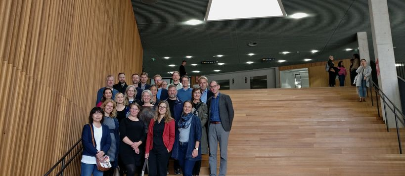 23 visitors from University of Copenhagen standing in the stairs of Väre building.