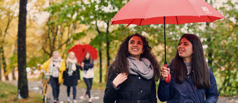 Two people with an umbrella.