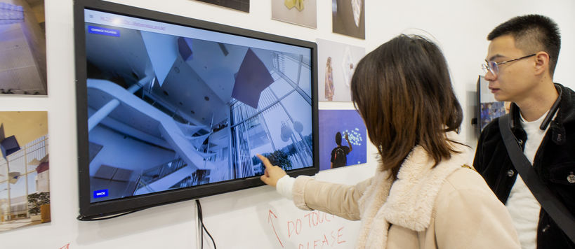 Visitors exploring the virtual exhibition on a touch screen
