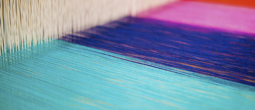 ARTS studio with a close-up on colourful yarns on a loom, image by Mikko Raskinen