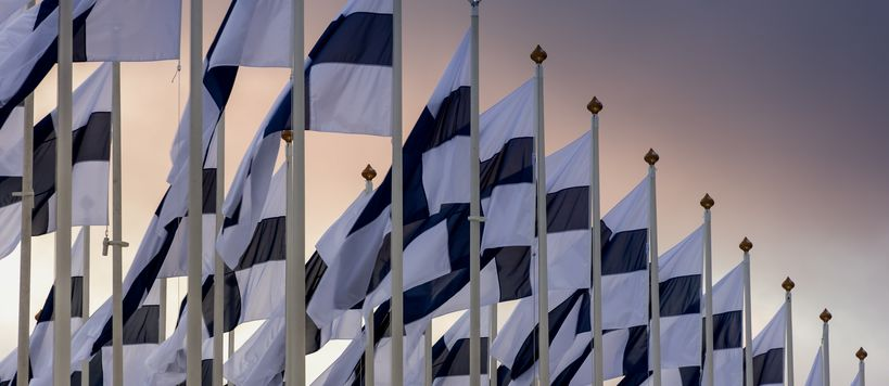 Finnish flags on gradient sky