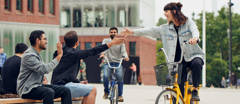Students with bikes on Aalto University campus