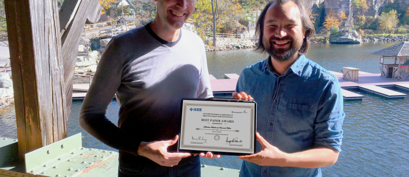 professor Habets and professor  Schlecht holding the best paper award certificate