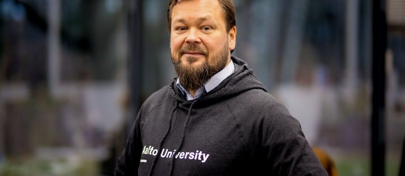 Ville Jokela Aalto CRE Managing Director smiling to the camera, wearing Aalto University hoodie. Pic: Kalle Kataila / Aalto University