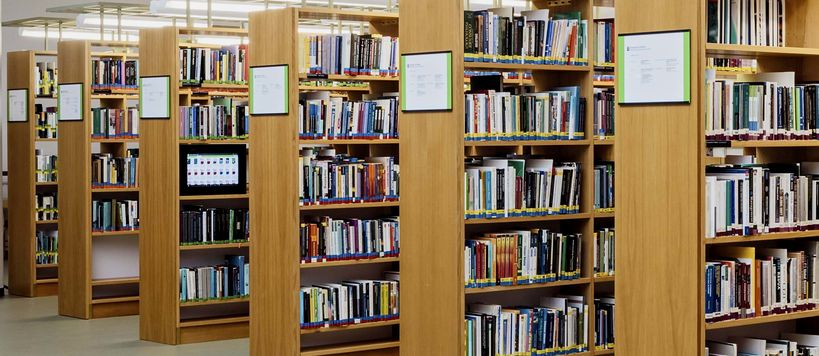 Book shelves in the library full of books