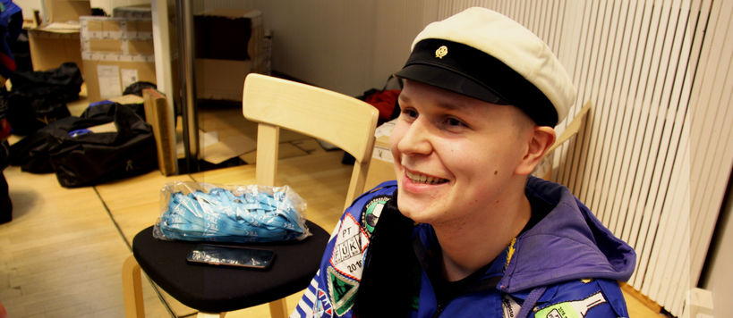 Jani Anttila in his blue overalls smiling