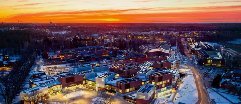 A wintery evening shoot of Aalto University campus when the sun is setting down, the School of Business main building in focus