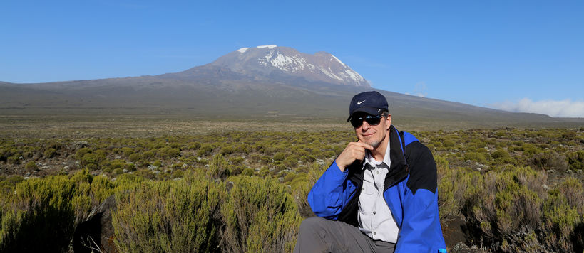 Dr. David Volkman in Kenya with Mount Kilimanjaro in the background.
