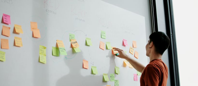 An ITP student brainstorming with post-it notes