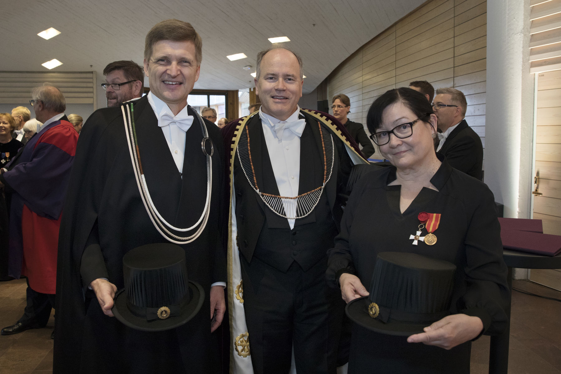 From left: President Niemelä, Dean Marquis and Conferrer Virrantaus