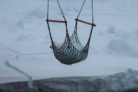 Fishing for ice in the Antarctic.