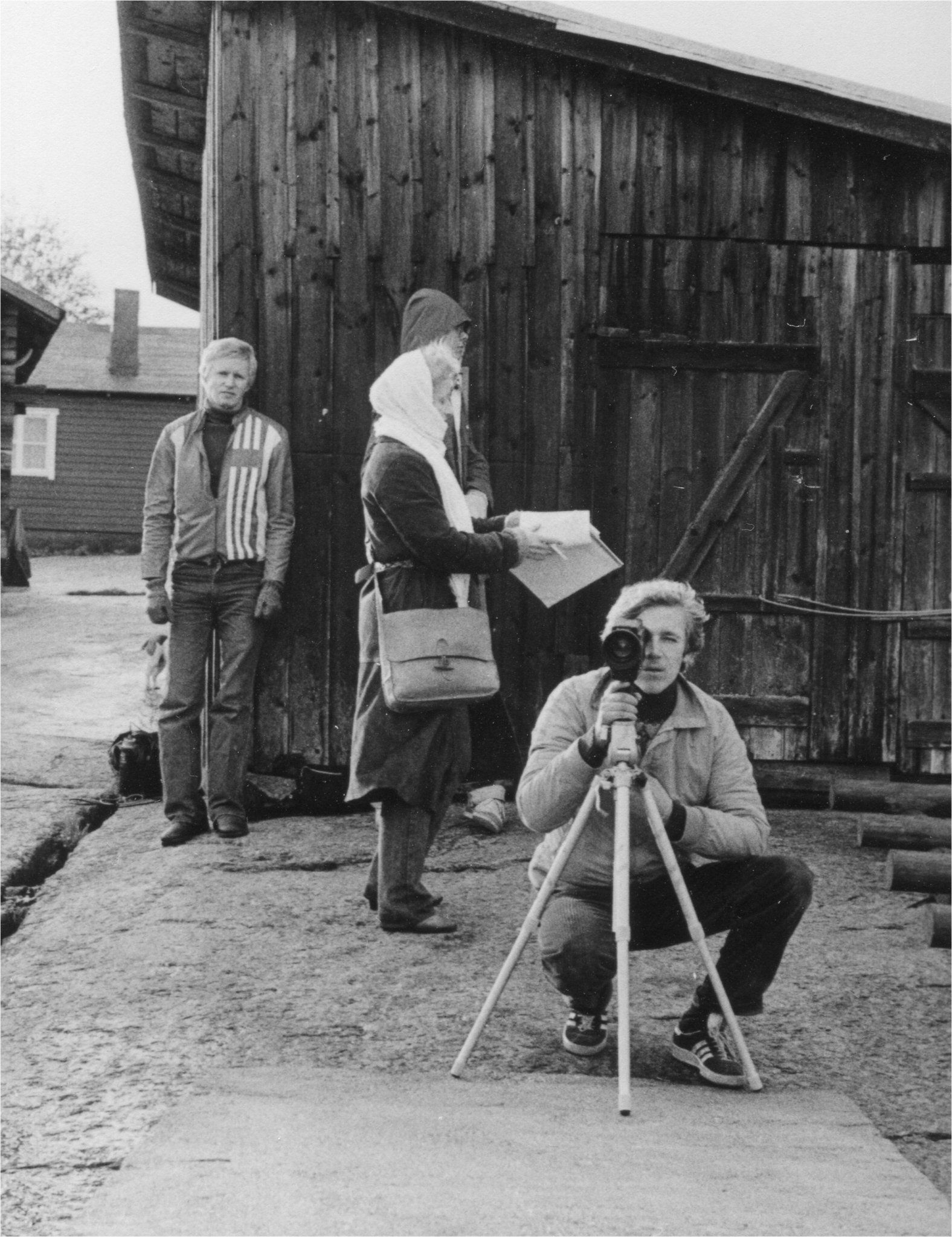 four people and camera in black and white country setting