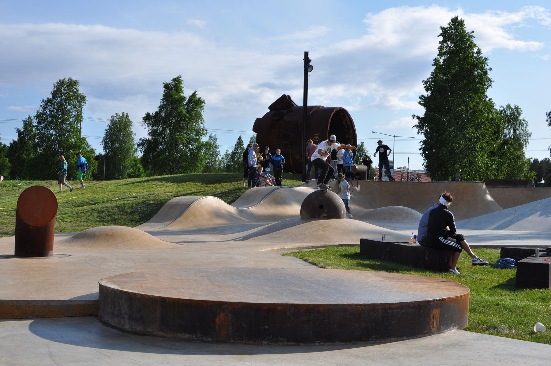 men skateboarding in skatepark