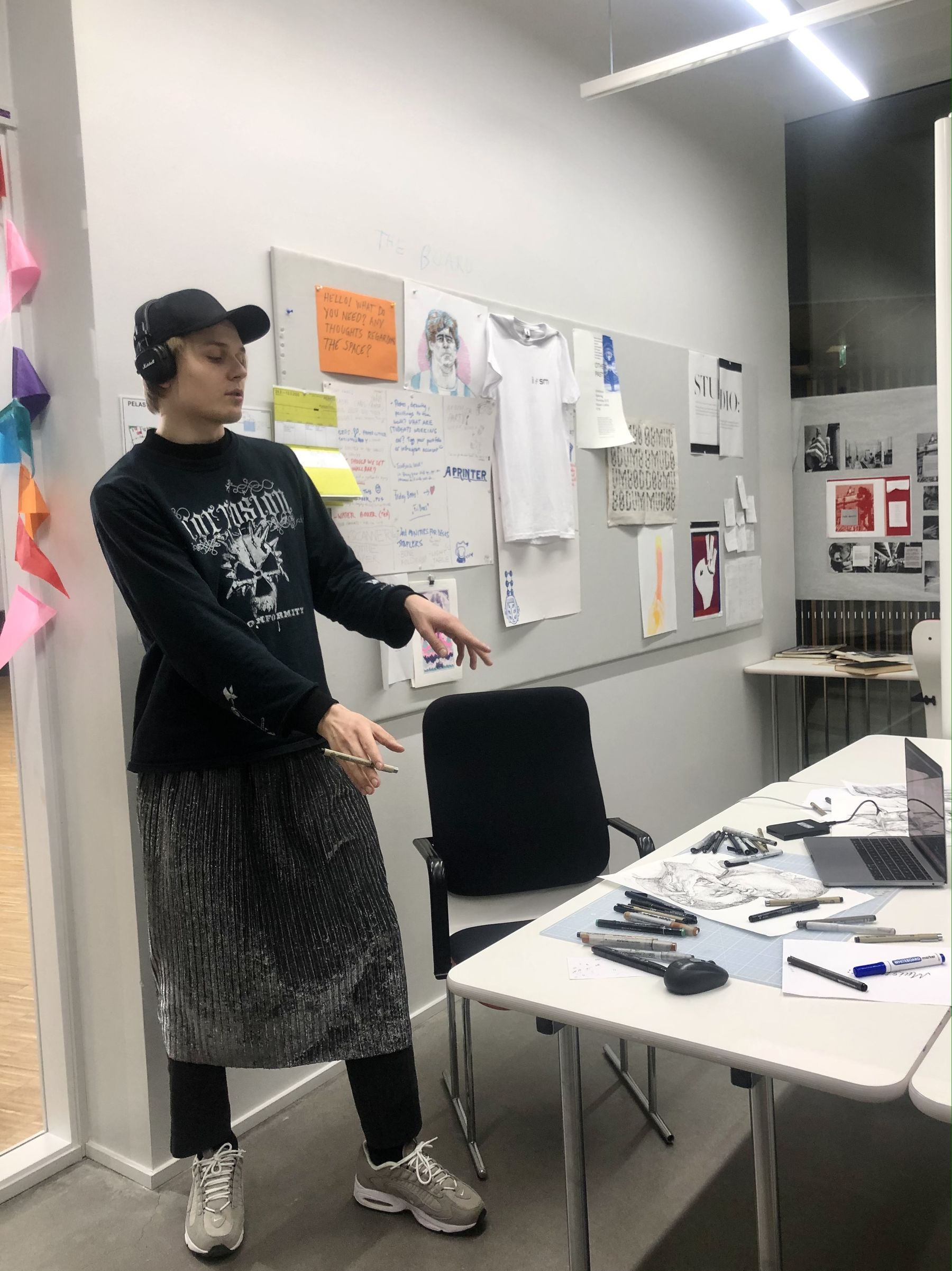 Artist standing in work room